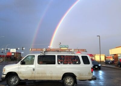 R Miller's Electrical van with rainbow